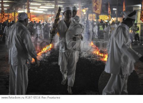 Mandatory Credit: Photo by Mohd Daud/NurPhoto/REX Shutterstock (5287894d) Malaysian Chinese devotees walk on a bed of hot coals Nine Emperor Gods Festival, Kuala Lumpur, Malaysia - 21 Oct 2015