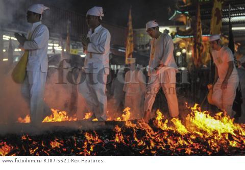 Mandatory Credit: Photo by Mohd Daud/NurPhoto/REX Shutterstock (5287894i) Malaysian Chinese devotees walk on a bed of hot coals Nine Emperor Gods Festival, Kuala Lumpur, Malaysia - 21 Oct 2015