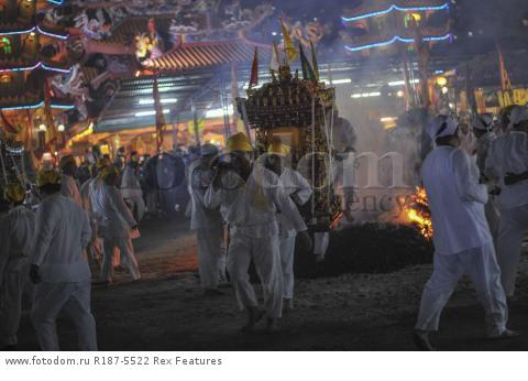 Mandatory Credit: Photo by Mohd Daud/NurPhoto/REX Shutterstock (5287894j) Malaysian Chinese devotees walk on a bed of hot coals Nine Emperor Gods Festival, Kuala Lumpur, Malaysia - 21 Oct 2015