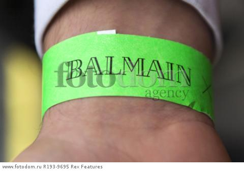 Mandatory Credit: Photo by Ray Tang/REX Shutterstock (5346899af) Customer wearing a wristband issued by H&M to get into the store at an allotted time Balmain x H&M launch, London, Britain - 05 Nov 2015