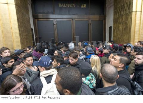 Mandatory Credit: Photo by Ray Tang/REX Shutterstock (5346899e) Customers queuing up outside the Regent Street store Balmain x H&M launch, London, Britain - 05 Nov 2015