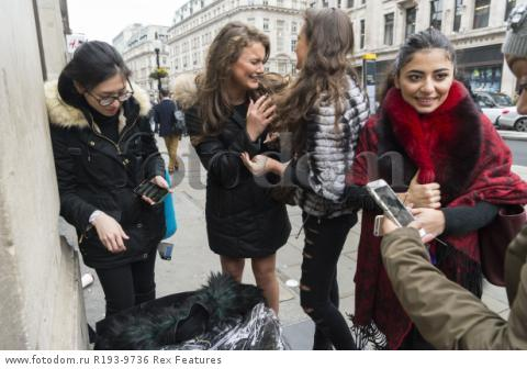 Mandatory Credit: Photo by Ray Tang/REX Shutterstock (5346899z) Customers with their purchased clothes outside the Regent Street store Balmain x H&M launch, London, Britain - 05 Nov 2015