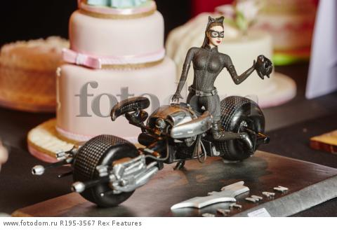 MANDATORY CREDIT: Cake International/REX Shutterstock. Only for use in this story. Editorial Use Only. No stock, books, advertising or merchandising without photographer's permission Mandatory Credit: Photo by Cake International/REX Shutterstock (5355636x) A cat-woman themed cake Cake International, Birmingham, Britain  - 07 Nov 2015 FULL COPY: http://www.rexfeatures.com/nanolink/rh2g  A series of amazingly wacky cake creations were unveiled this weekend at the Cake International event in Birmingham (6-8 November).  From life-size dinosaurs, to miniature Disney themed cakes, there is something for everyone at the famous show-stopping event.  Cake International is an annual event, which takes place at Birmingham's NEC.  Hundreds of cake designers attend the event, to show-case their incredible cake-art skills.  In the photos, there is a giant Maleficent from Disney's Sleeping Beauty, a life-size dinosaur head, and a life-size Game of Thrones themed cake.