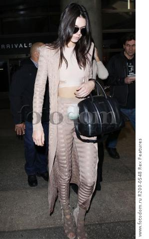 Mandatory Credit: Photo by Broadimage/REX Shutterstock (5403038d) Kendall Jenner Kendall Jenner and Kylie Jenner at LAX International Airport, Los Angeles, America - 19 Nov 2015 Kendall Jenner and sister Kylie Jenner arrives at the Los Angeles International Airport