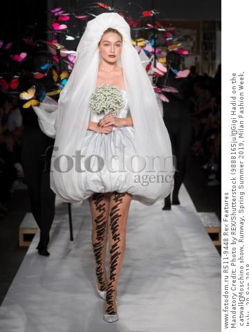 Mandatory Credit: Photo by REX/Shutterstock (9888165ju) Gigi Hadid on the catwalk Moschino show, Runway, Spring Summer 2019, Milan Fashion Week, Italy - 20 Sep 2018