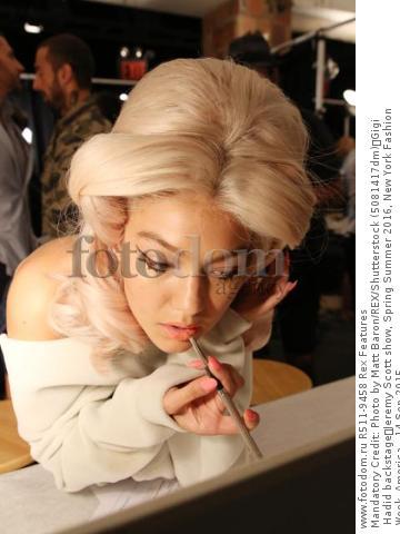 Mandatory Credit: Photo by Matt Baron/REX/Shutterstock (5081417dm) Gigi Hadid backstage Jeremy Scott show, Spring Summer 2016, New York Fashion Week, America - 14 Sep 2015