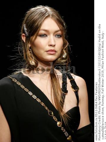 Mandatory Credit: Photo by WWD/REX/Shutterstock (10113240i) Gigi Hadid on the catwalk Versace show, Runway, Fall Winter 2019, Milan Fashion Week, Italy - 22 Feb 2019