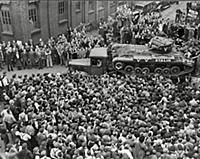 Crowds of people and a guard of honour of tanks, m
