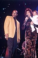 Bobby Brown and Whitney Houston with baby daughter