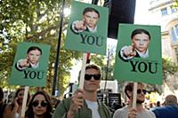 Climate change protestors holds a placards depicti