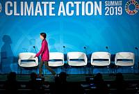 Climate activist Greta Thunberg leaves the stage a