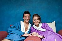 couple relaxing at spa in bath robes