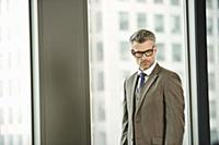 Portrait of mature businessman in high rise office