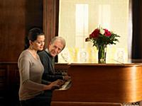 Senior father and daughter playing duet