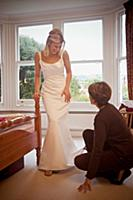 A bride having her dress fitted