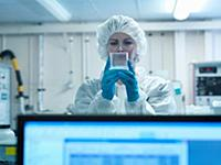 Female scientist wearing protective clothing in a
