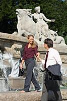 Smiling couple beside fountain