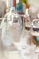 Close up of empty wine bottle and wine glasses