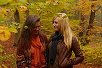 Mother and daughter talking in forest