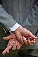 Businessman crossing his fingers