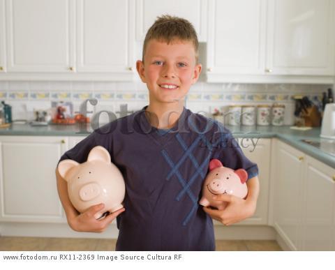 Boy Holding Piggy Banks