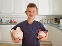 Boy Holding Piggy Banks