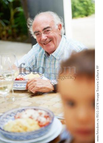Grandfather having lunch