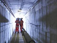 Civil engineers in discussion in tunnel of suspens