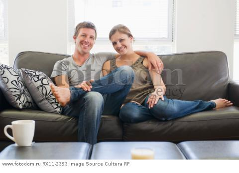 Couple relaxing on couch together
