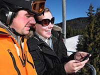 Couple playing game on ski-lift