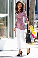 A young brunette woman shopping in Miami wearing w