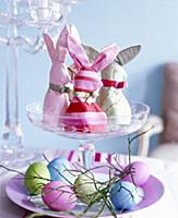 Homemade rabbit-shaped egg cosies and coloured egg