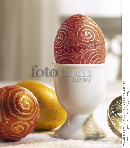 Close-up of painted Easter egg in egg cup