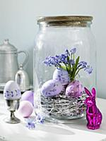 Purple Easter eggs in a preserving jar with an Eas