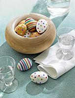 Easter eggs in bowl decorated with confetti and co