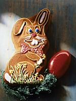 Cake in the form of Easter bunny decorated with ic