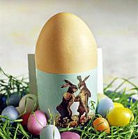 Close-up of Easter egg in green egg cups decorated