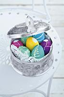 Close-up of colourful Easter eggs in silver box
