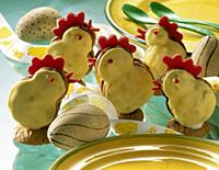 Marzipan chick with eggs and plates with green spo