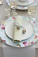 A place setting decorated with a rolled napkin and