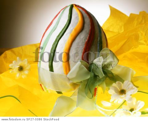 Large sponge Easter egg decorated with colourful icing