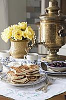 Blinis (honey-yeast pancakes, Russia) with cherry
