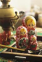 Matryoshka dolls, samovar and glasses in backgroun