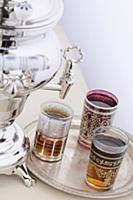 Samovar with three glasses and black tea