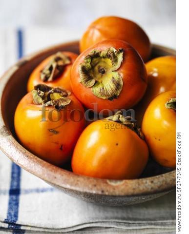 Kaki fruit in a ceramic bowl