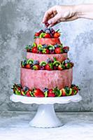 Red cake with watermelon, strawberries, raspberrie