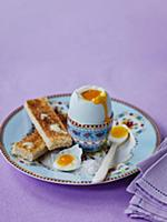 Boiled egg and buttered slices of toast