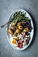 Antipasti platter with beans, potatoes, olives, eg