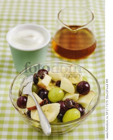 Fruit salad and greek yoghurt served with honey