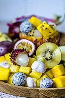 Exotic fruits on a wooden tray